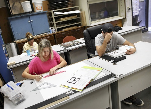 Seminole State College graphic-design student Taryn Milosevich, left front, works on a project in her Design 2D class at the Sanford campus. She recently received a professional certificate in digital design, a credential she didn't even realize she qualified for.