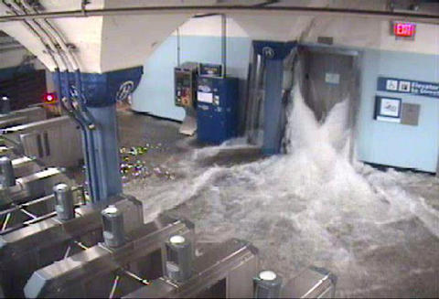 Floodwaters from Hurricane Sandy rush into the Port Authority Trans-Hudson's (PATH) Hoboken, New Jersey station through an elevator shaft, in this video frame grab from the NY/NJ Port Authority twitter feed October 29, 2012.