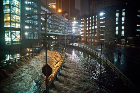 Water rushes into the Carey Tunnel, previously the Brooklyn Battery Tunnel, in the Financial District of New York after Superstorm Sandy hit the East Coast Monday evening.