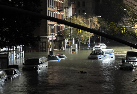 Cars become submerged on Avenue C and 7th Street in New York as Hurricane Sandy makes its way through Manhattan.