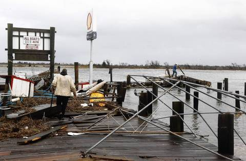 Ted Wondsel of Point Lookout, owner of Ted's Fishing Station, assesses the damage on October 30, 2012 in Long Beach, New York.
