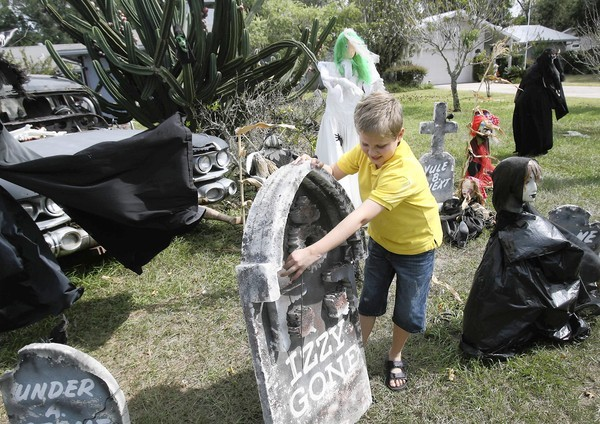 "For more than 15 years , Denise Cassella, with some help from her grandson Jack, 9,  has been decorating her home in Eustis  for Halloween ""Chesterfield Cemetery"" is a work in progress from October 1st until the 31 st. Casella keeps adding features until the very last night. ""I just love doing this"" said Cassella , ""this is my favorite time of the year, and the kids love it"". The day after Holloween , everything goes back into a trailer, and it's time for CHristmas decorations to come out.  (Tom Benitez/Orlando Sentinel)"