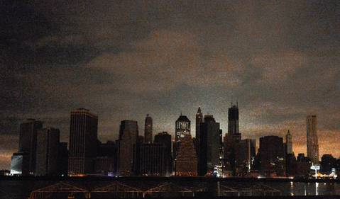 A darkened lower Manhattan is seen from Brooklyn in New York following Hurricane Sandy.