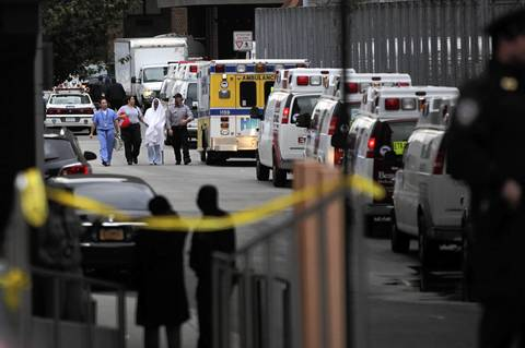 A person is evacuated from Bellevue Hospital in New York City. The hospital had been operating on backup generators since losing power during Hurricane Sandy but had to be evacuated once the extent of the damage became clear.