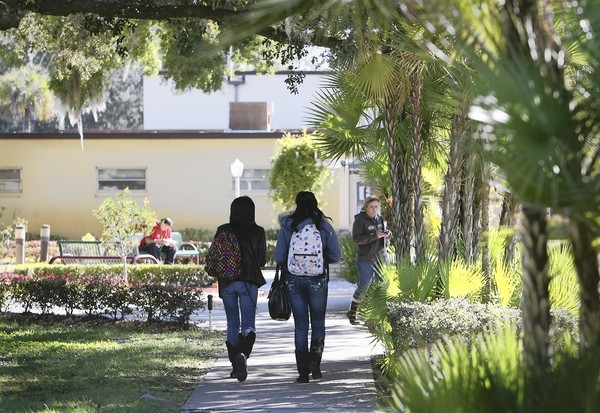 Students walk between classes at Lake-Sumter State College. The school changed its name to reflect a new mission to offer four-year degrees.