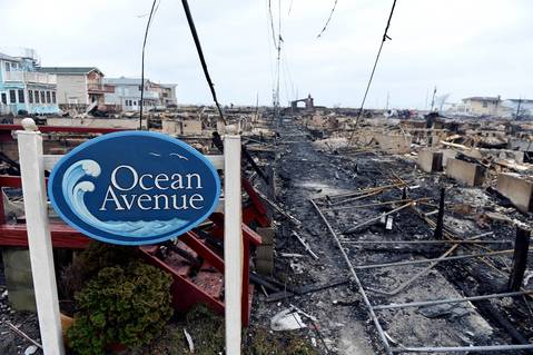 Homes on Ocean Avenue in the Breezy Point area of Queens in New York smolder the day after a fire destroyed about 80 homes as a result of Hurricane Sandy.