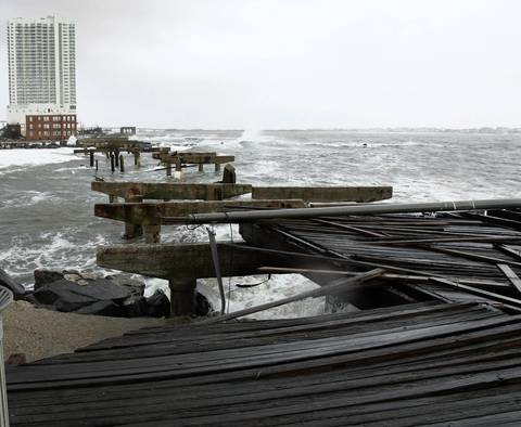 Remains of a demolished section of the boardwalk are scatter about at the end of Pacific Avenue in the north end of Atlantic City after Hurricane Sandy made landfall.