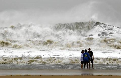 A wall of water makes its way to shore as residents take a dip in the big surf in Ocean City, Maryland, as Hurricane Sandy intensifies. About 50 million people from the Mid-Atlantic to Canada were in the path of the nearly 1,000-mile-wide storm, which forecasters said could be the largest to hit the mainland in U.S. history.