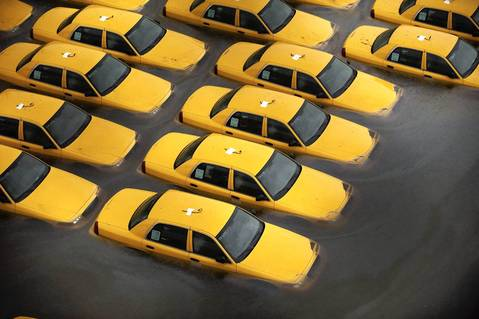 Taxis sit in a flooded lot after Hurricane Sandy in Hoboken, New Jersey.
