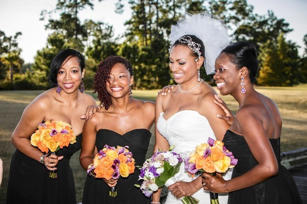 Bride Lakisha Smith with, from left, Diana Carpenter, Tonetta Stewart and Tiana Moody at the Waldorf Astoria in Orlando, Fla. on Friday, November 02, 2012.