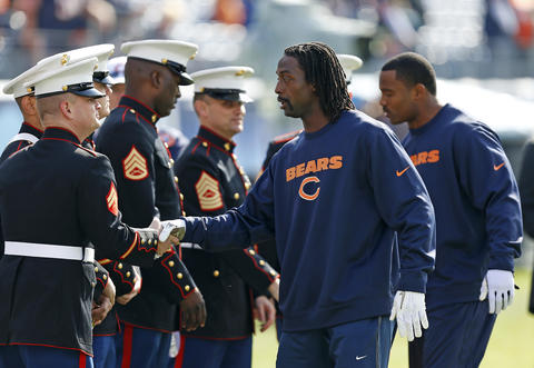 Chicago Bears cornerback Charles Tillman (front) shake hands with United States Marines who are on the sidelines to watch the pre-game warmups before a game against the Tennessee Titans at LP Field in Nashville, Tenn. on Sunday.