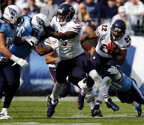 Running back Matt Forte moves the ball against the Titans in the first quarter.