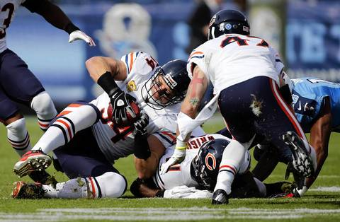 Brian Urlacher recovers a fumble from Titans wide receiver Kenny Britt in the first quarter.