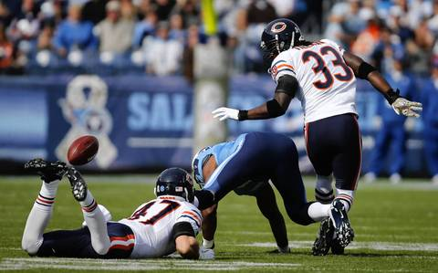 Charles Tillman forces Titans wide receiver Kenny Britt to fumble in the first quarter. Brian Urlacher recovered it.
