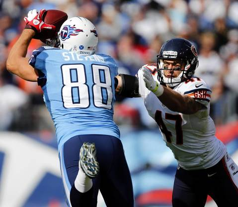 Chris Conte forces an incompletion to Titans tight end Craig Stevens in the first quarter.