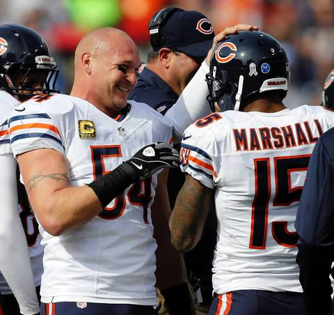Brian Urlacher celebrates Brandon Marshall's touchdown in the first quarter.