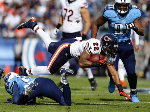Running back Matt Forte dives for more yards in the first quarter.