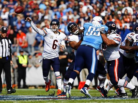 Quarterback Jay Cutler completes a pass to wide receiver Earl Bennett in the first quarter.