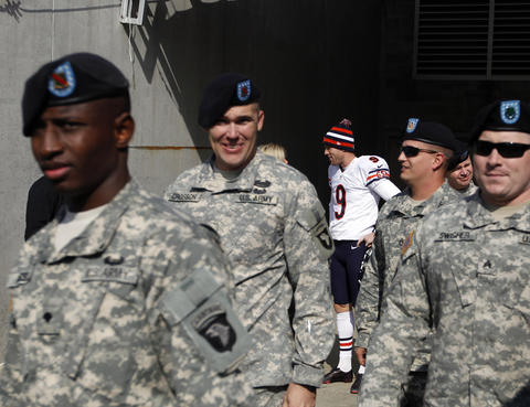 Chicago Bears kicker Robbie Gould (9) takes the field behind members of the U.S. military Sunday at LP Field in Nashville, Tenn.