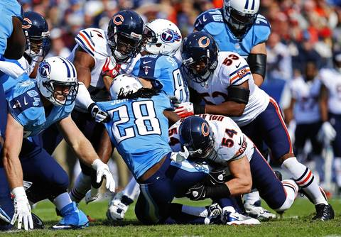 Titans running back Chris Johnson goes right into the Bears defense in the first quarter.