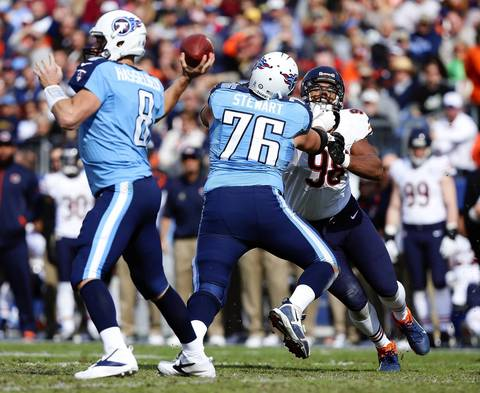 Defensive end Corey Wootton pass rushes as Titans tackle David Stewart pass blocks for Titans quarterback Matt Hasselbeck in the first quarter.