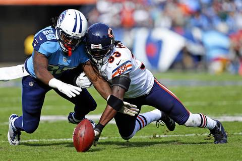 Charles Tillman strips a ball thrown to the Titans' Chris Johnson, forcing the fumble which is recovered by the Bears in the first quarter.