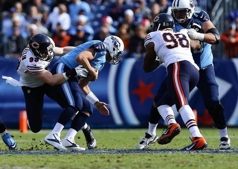 Defensive end Shea McClellin tackles Titans quarterback Matt Hasselbeck in the second quarter.