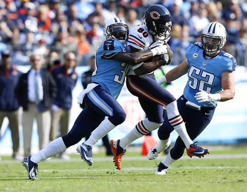 Wide receiver Earl Bennett is tackled by Titans cornerback Jason McCourty in the second quarter following a reception.