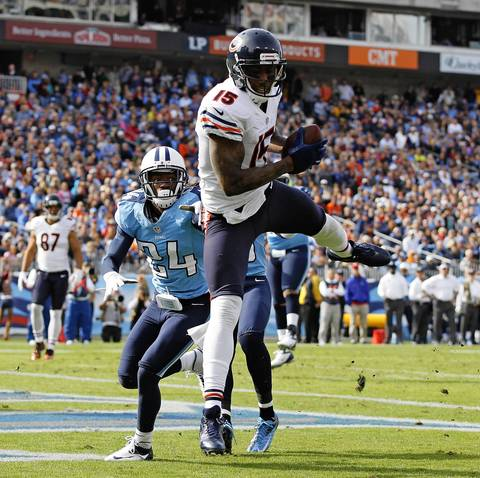 Brandon Marshall catches a touchdown against Titans cornerback Coty Sensabaugh in the first quarter.