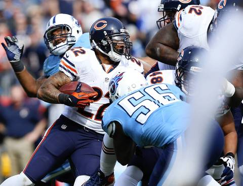 Running back Matt Forte runs behind the offensive line for a touchdown in the first quarter.