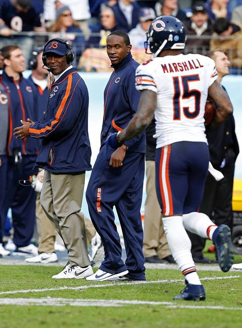 Coach Lovie Smith is all smiles after Brandon Marshall makes a touchdown catch in the fourth quarter as injured teammate Alshon Jeffery looks on.