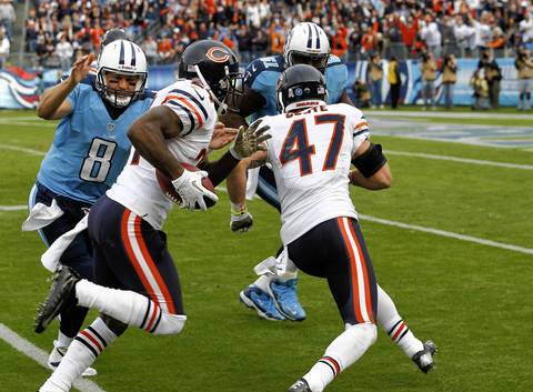 Kelvin Hayden recovers a fumble and is then tackled by Titans quarterback Matt Hasselbeck in the fourth quarter.
