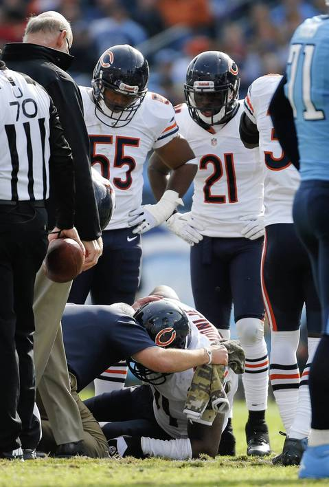 Defensive end Israel Idonije goes down with an injury in the second quarter.