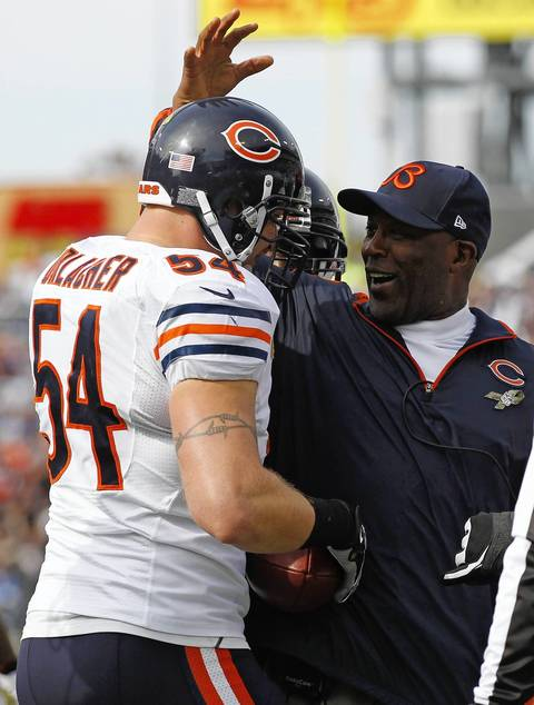 Coach Lovie Smith celebrates Brian Urlacher's interception return for a touchdown against the Titans in the first quarter.