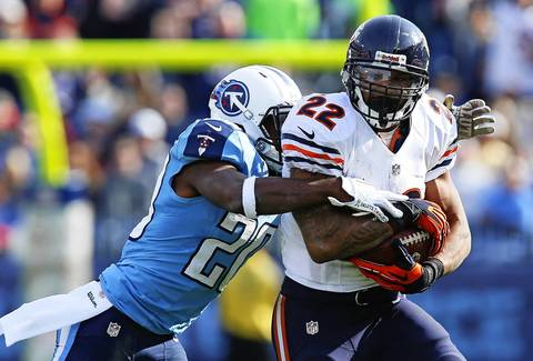 Matt Forte gains big yards in the second quarter before he's tackled by Titans cornerback Alterraun Verner.