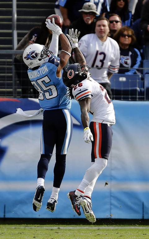Titans wide receiver Nate Washington catches a touchdown over cornerback Tim Jennings in the third quarter.