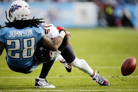 Cornerback Tim Jennings forces an incomplete pass against the Titans' Chris Johnson in the third quarter.