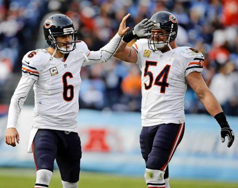 Jay Cutler and Brian Urlacher celebrate another touchdown pass to Brandon Marshall.