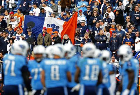 Bears fans wave their flag in the fourth quarter as the Titans offense is on the field at LP Field in Nashville.