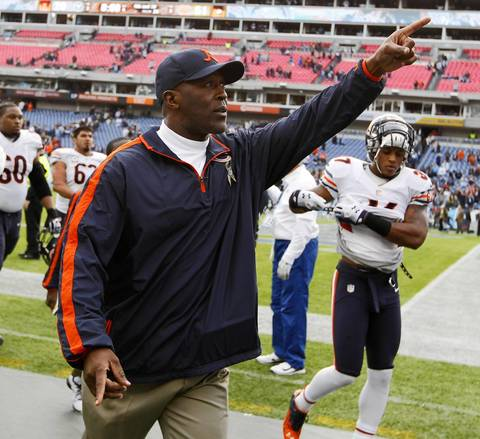 Bears coach Lovie Smith acknowledges the fans as leaves the field.