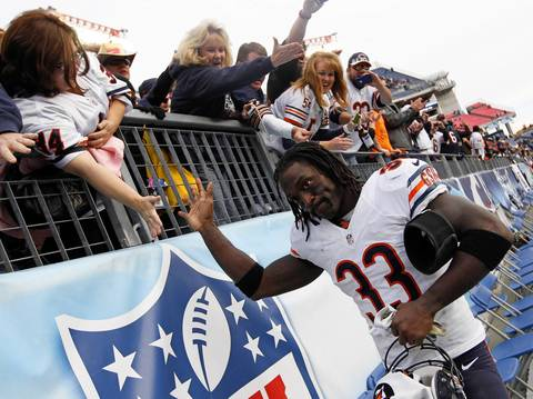 Charles Tillman greets fans as the leaves the field after the win.