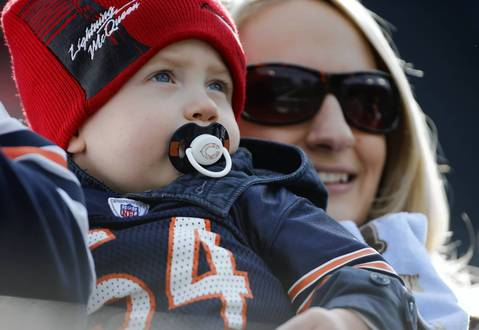 A young Brian Urlacher fan cheers on the Bears against the Titans.