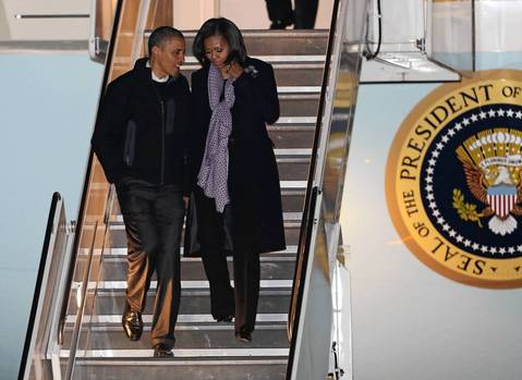 President Barack Obama and his wife Michelle leave Air Force One after arriving at O'Hare International Airport in Chicago.