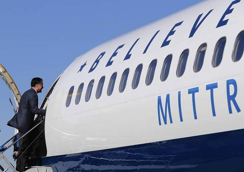 Republican presidential candidate Mitt Romney boards his campaign plane in Bedford, Massachusetts.