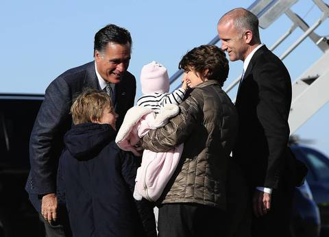 Republican presidential candidate, former Massachusetts Gov. Mitt Romney greets a family before boarding his campaign plane in Bedford, Massachusetts.