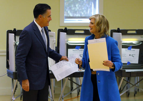 Republican presidential candidate Mitt Romney and his wife Ann complete their ballots for the U.S. presidential election in Belmont, Mass.
