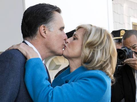 Republican presidential candidate Mitt Romney and his wife Ann kiss after casting their votes in the US presidential elections in Belmont, Massachusetts,