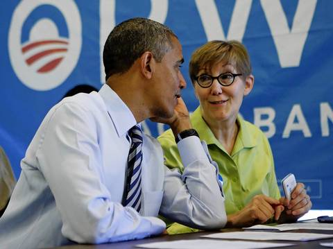 President Barack Obama talks to volunteer Carla Windhorst during a visit to a campaign office in the Hyde Park neighborhood.