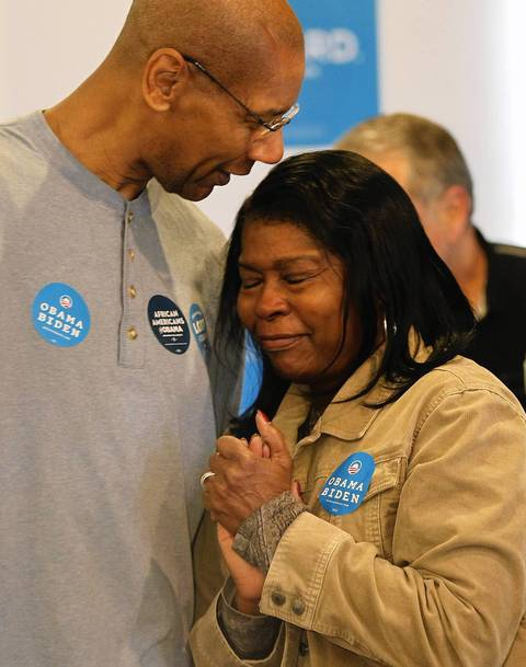 A volunteer becomes emotional as President Barack Obama visits a campaign office in the Hyde Park neighborhood on election day.