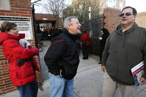 U.S. Senator Dick Durbin and his wife Loretta chat with precinct captain Joe Poelsterl outside the Broadway United Methodist Church in Chicago where a line snakes around the block with voters. Durbin votes in Springfield and just happened to be walking by.